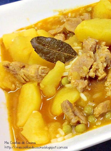 Guiso de patatas con cabezada de lomo y arroz